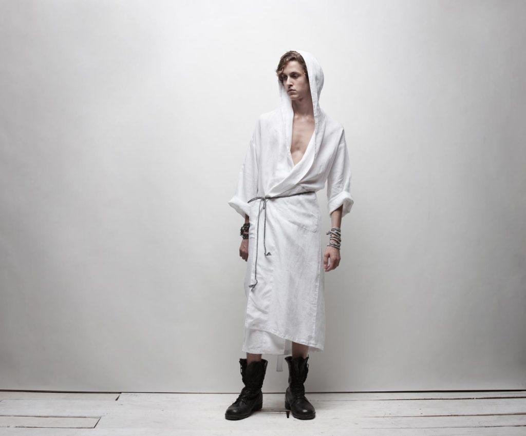 A fashion photo photograph taken by Nick Reid of a model wearing a white bathrobe with a hood by Matteo.