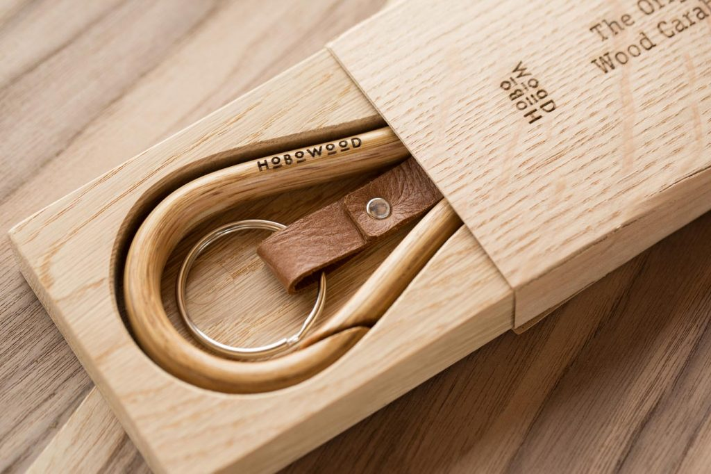Handmade wooden carabiners in veneer box .