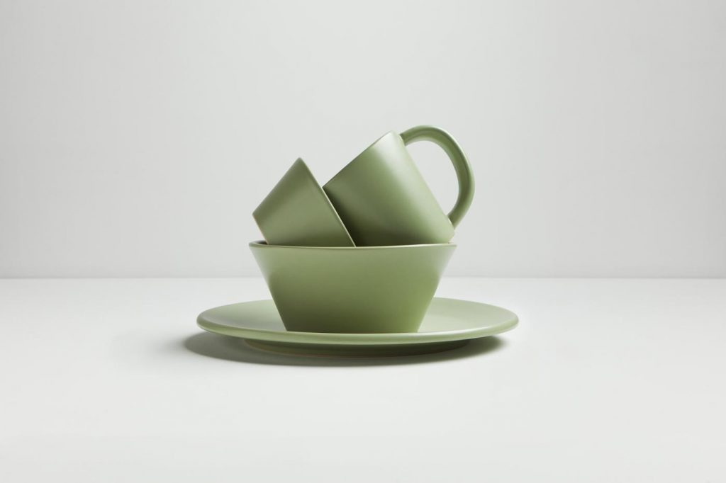 A green serving set stacked artistically by food photographer Nick Reid.