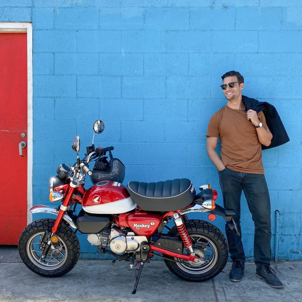 Smiling man next to a Honda monkey by Los Angeles based animated gif photographer Nick Reid